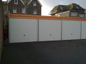 Battery garages with white roller shutters