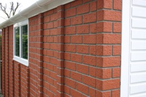 Brick effect cladding on a plywood garage finish