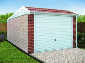 A pent mansard garage with brick effect pillars and tiled roof