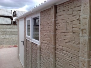 stone effect cladding on a plywood garage finish