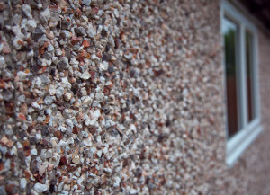 Pebbledash is available on the pent mansard and is shown as a close up here