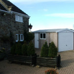 Rockstone Installation with side access door and windows in white