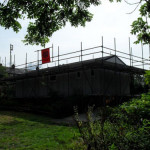 Large Apex concrete garage with scaffolding errected