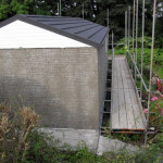Large Apex concrete garage with slate colour roof