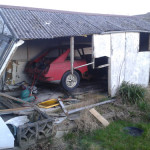 Car in old broken down garage