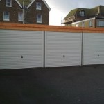 Battery Garages in White and timber closeup