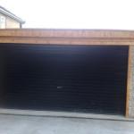Brown roller door on a Pent double garage
