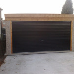 Pent double garage with timber front and roller door