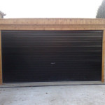 Pent double garage with timber front