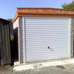 Pent Single Garage with light timber fascia front view 2