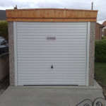 Pent Single Garage with light timber fascia front