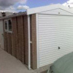 Rockstone front view with white roller shutter doors